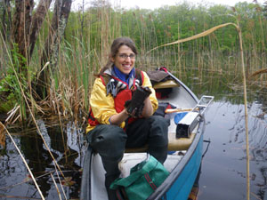 Dr. Julia G. Lazar holding a recently collected subaqueous soil core on Pond C, along Roaring Brook in Washington County, RI, USA.  Cores were extracted with the metal soil corer from the canoe, wrapped and transported back to the University of Rhode Island for mesocosm experiments.